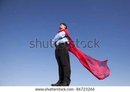 Businessman with a red flying cape like superman - stock photo