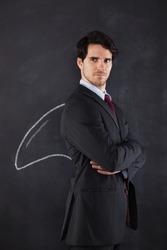 Businessman with a shark fin draw on the blackboard