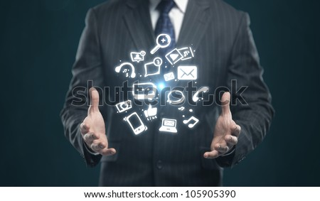 Businessman with a social media icon on his hands
