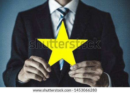 Businessman with a star in hand