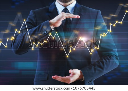 Businessman with abstract glowing forex chart on blurry background. Fund management and analysis concept