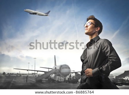 Businessman with airport in the background