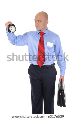 businessman with an alarm clock in a hand. Isolated on white background