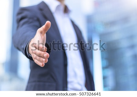 Businessman with an open hand ready for handshake - concept about agreement, partnership and win-win situation #507326641