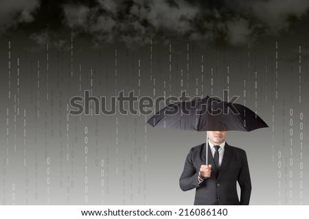Businessman with an umbrella among binary code digital rain storm antivirus and firewall protection concept