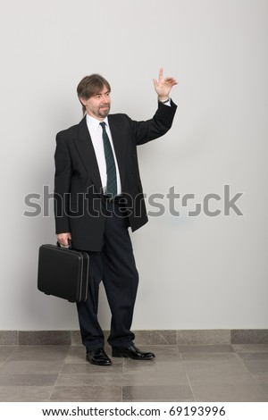 Businessman with arm raised in salute.