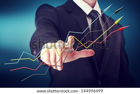Businessman with arrows representing growth on a navy blue background