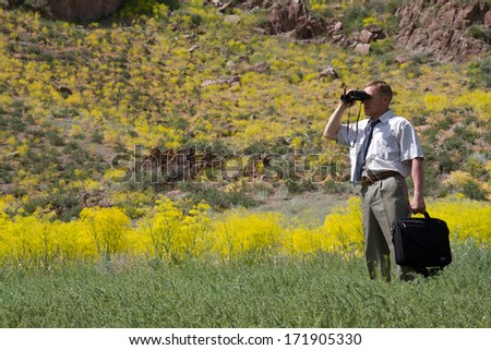 businessman with binoculars looking to the future, horizontal frame