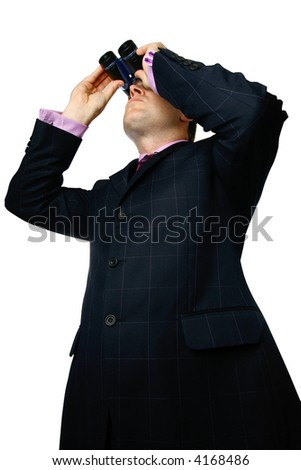 Businessman with binoculars looking up, isolated.