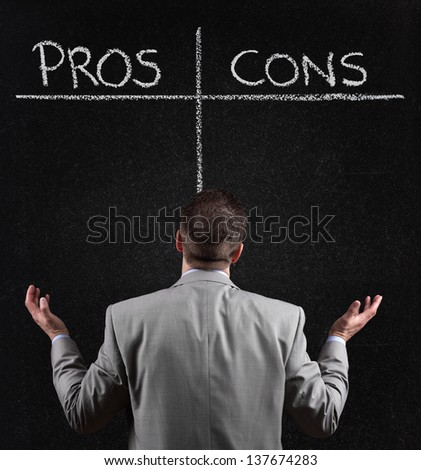Businessman with blackboard list of pros and cons, for and against argument concept