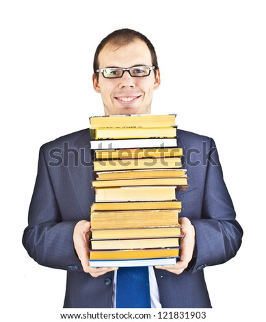 Businessman with books on gray background