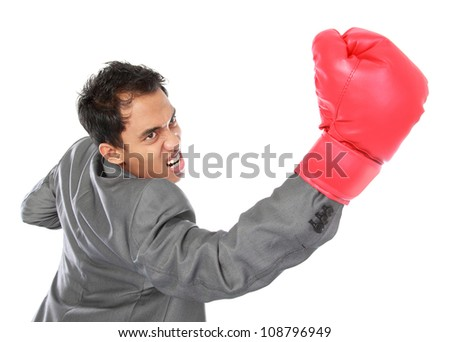 businessman with boxing glove hit something