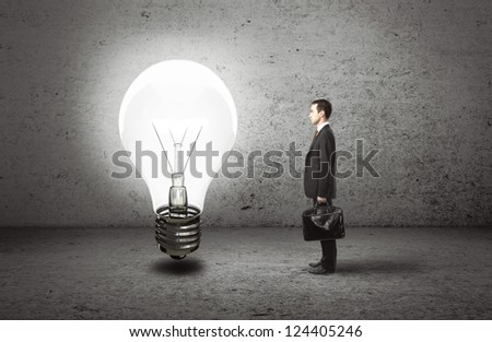 businessman with briefcase and lamp, idea concept