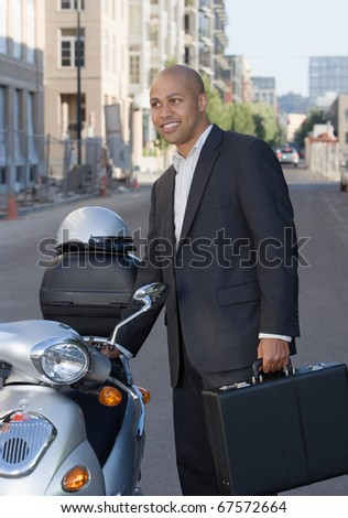 Businessman with briefcase next to scooter