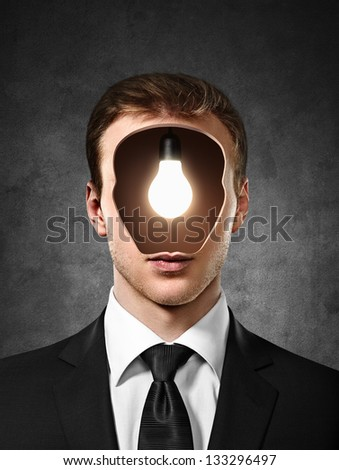 businessman with bulb inside head