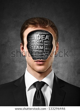 businessman with business tags inside head on concrete background