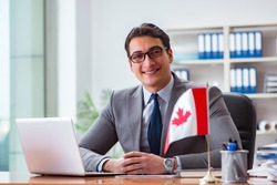 Businessman with Canadian flag in office