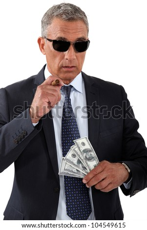 Businessman with cigar and money