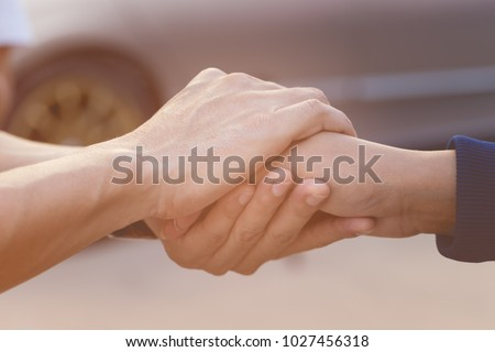 Businessman with client holding hands together for comfort and support work together, insurance team,respect and trust concept