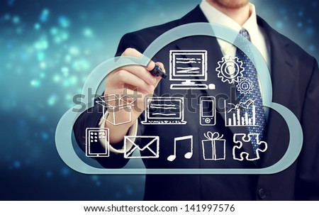 Businessman with cloud computing concept on blue background