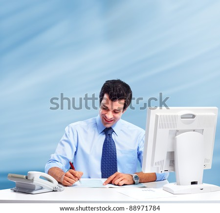 Businessman with computer working at the office.