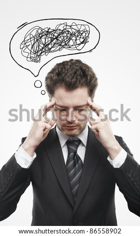Businessman with confusing tangle of thoughts. Thinking man. Conceptual image of a open minded man. On a gray background