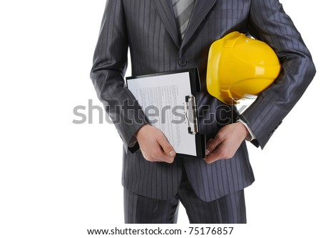 Businessman with construction helmet and clipboard . Isolated on white background