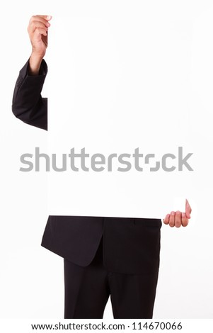 Businessman with dar suit holding blank board.