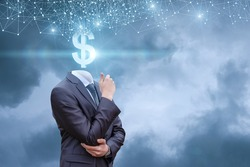 Businessman with dollar sign instead of a head against the sky.