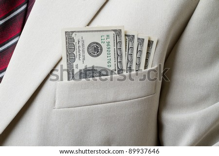 Businessman with dollars in the breast pocket