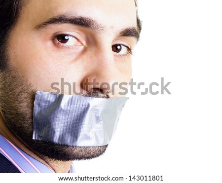 Businessman with duct tape on mouth, white background. Conceptual image.