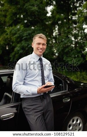 Businessman with e-reader. Smiling.