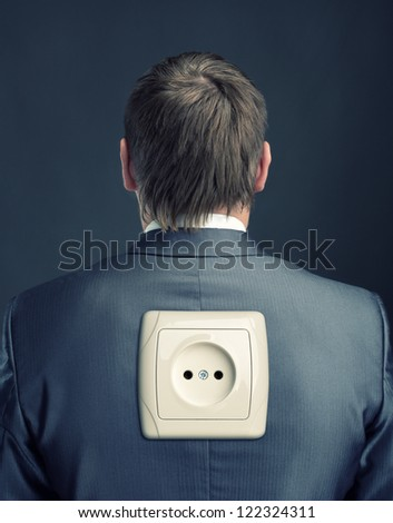 Businessman with electrical outlet on back