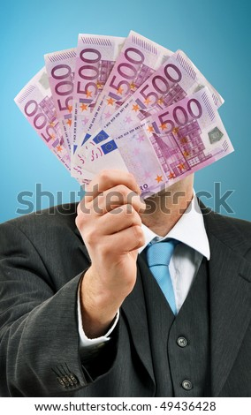 Businessman with 500 euros banknotes handful, money loan from the bank, financial security, monthly salary, payment concept