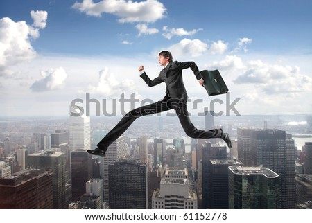 Businessman with extreme long legs jumping from a skyscraper to another