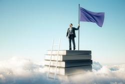 Businessman with flag standing on abstract book stack with ladder on sky and clouds background. Growth and leadership concept
