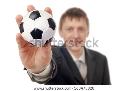Businessman with football isolated on white.