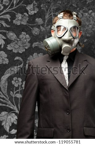 Businessman With Gas Mask against a vintage background