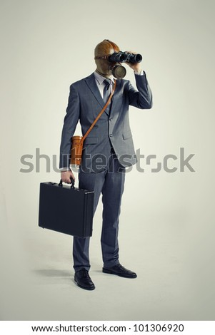 Businessman with gas mask  looking through binoculars