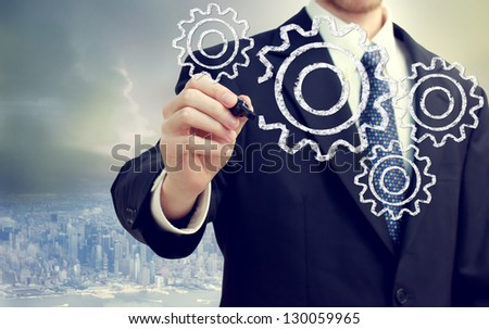 Businessman with gears - concepts of teamwork, efficiency, interlocking parts.