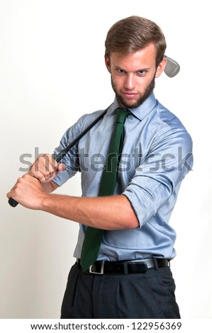 Businessman with golf club isolated