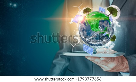 Businessman with Green planet. Renewable energy and efficency concept. 3D rendering. Environmental biodiversity. 3D rendering. Some Elements Of This Image Provided By NASA Foto stock ©