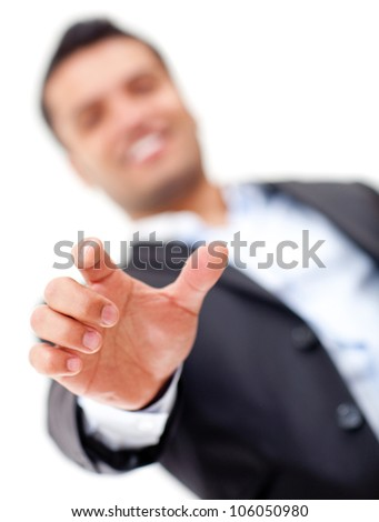 Businessman with hand extended about to point at something - isolated over white