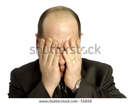 Businessman with hands over his face isolated on white background - stock photo