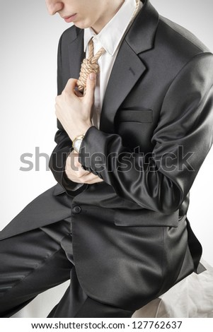 Businessman with hangman's noose instead of tie symbolizing economic breakdown.