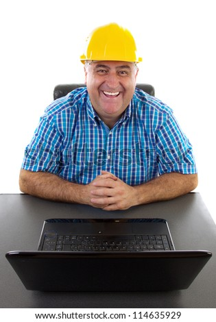 Businessman with hardhat at his laptop, safe business concept