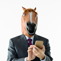 Businessman with head of horse on white background.
