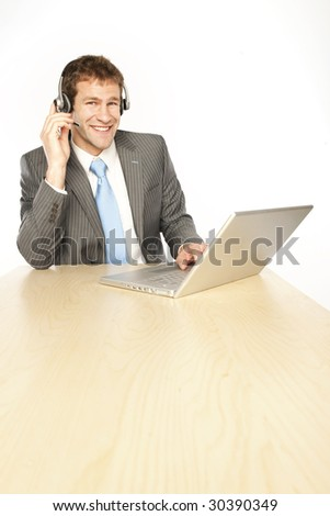 Businessman with headphones and laptop on telesales center