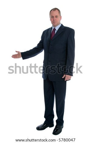 Businessman with his arm out in a welcoming gesture.