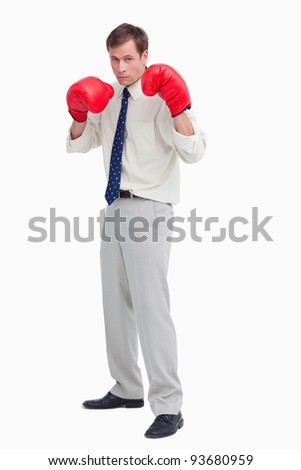 Businessman with his boxing gloves ready to fight against a white background
